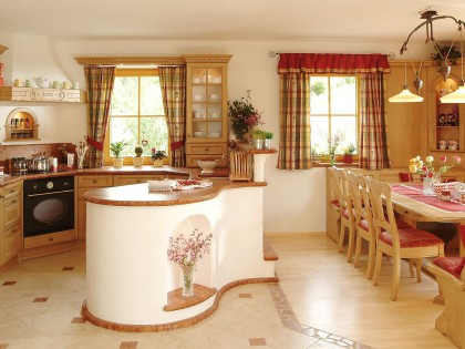 Küche KIRCHBACH mit Arbeitsinsel und eingebauter Essecke